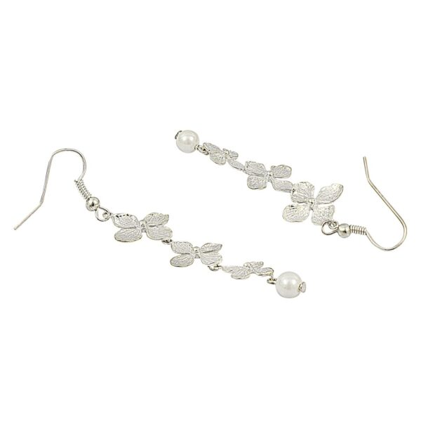 Long silver color floral earrings with a drop of white pearl